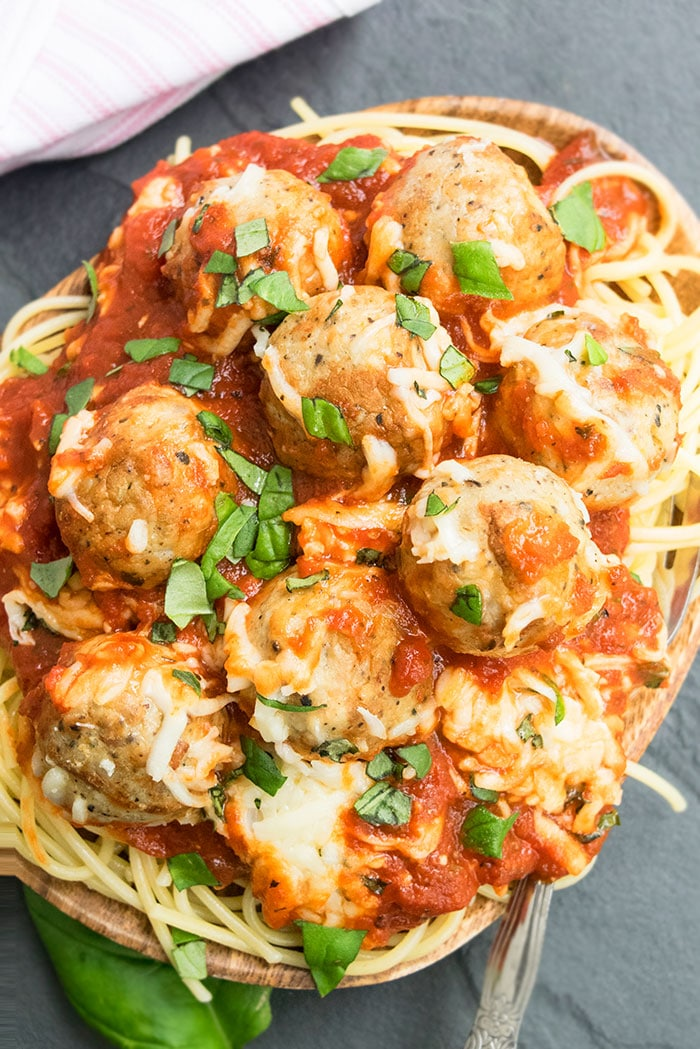 Plate of Spaghetti and Homemade Meatball Parmesan on Black Board