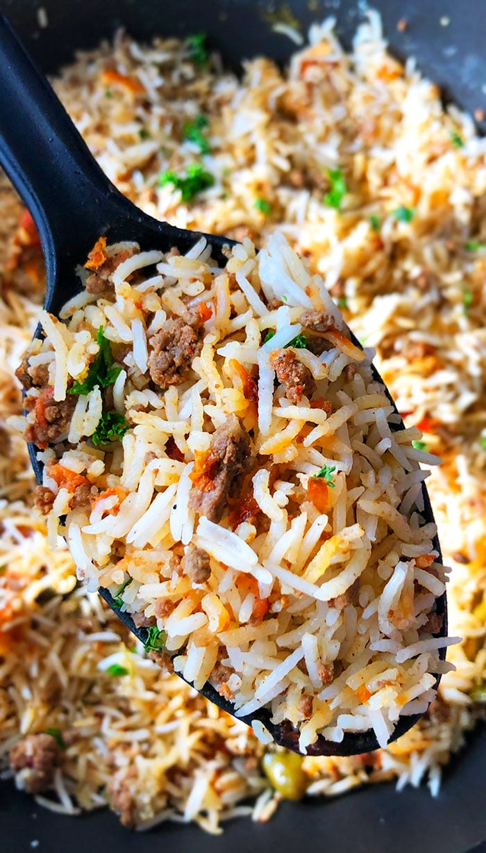 Closeup of Spoonful of Dirty Rice (Ground Beef and Rice)