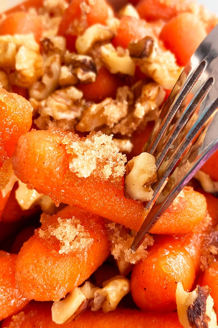 Fork with Candied Carrots Garnished with Brown Sugar and Nuts