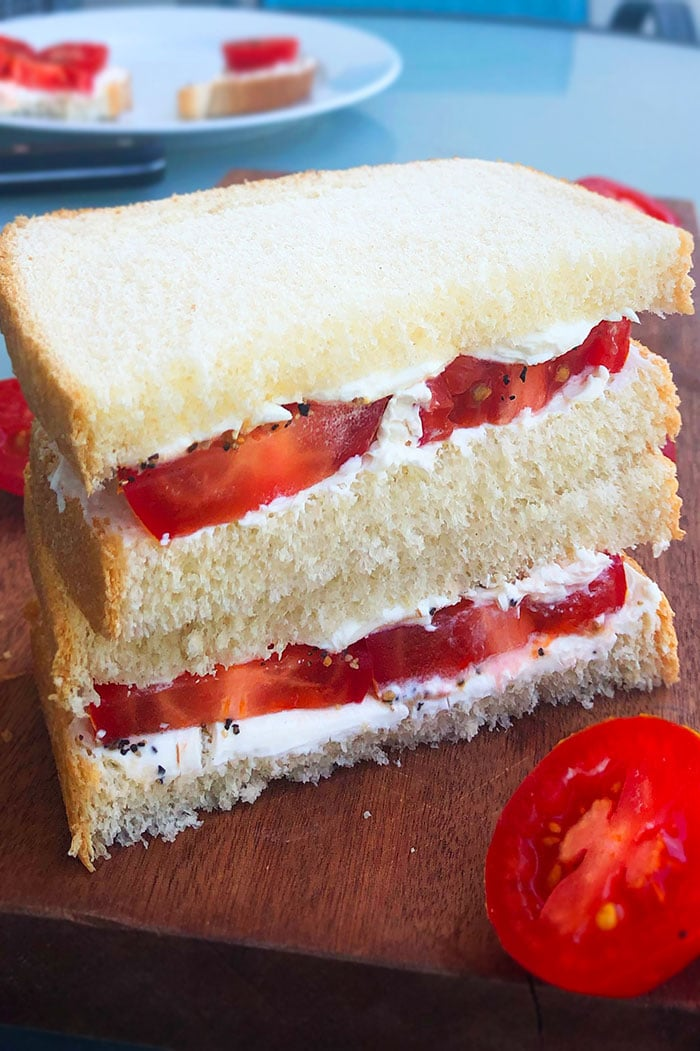 Stack of Fresh Tomato Sandwiches on a Wood Board