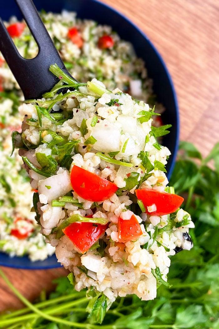 Closeup Shot of Spoonful of Tabouli Salad