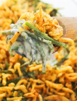 Spoonful of Best Green Bean Casserole with Fried Onions- Closeup Shot
