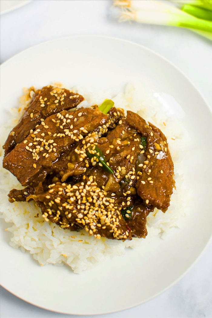 Overhead Shot of Easy Homemade Mongolian Beef With Mongolian Sauce and Rice in White Plate