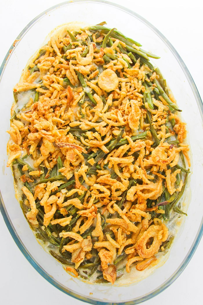 Overhead Shot of Homemade Green Bean Casserole With Crispy Fried Onions in Glass Dish