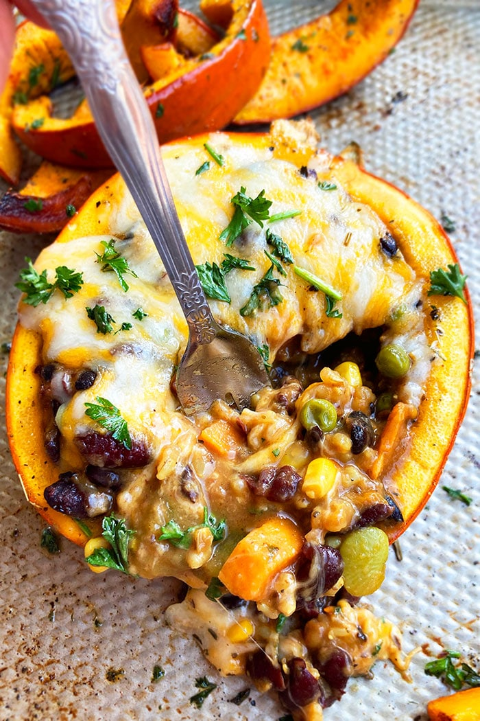 Easy Mini Stuffed Pumpkin with Meat, Vegetables, Beans and Cheese with Partial Scoop on Silver Baking Tray
