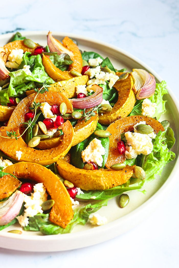 Easy Homemade Pumpkin Salad with Lemon Vinaigrette Dressing on White Plate