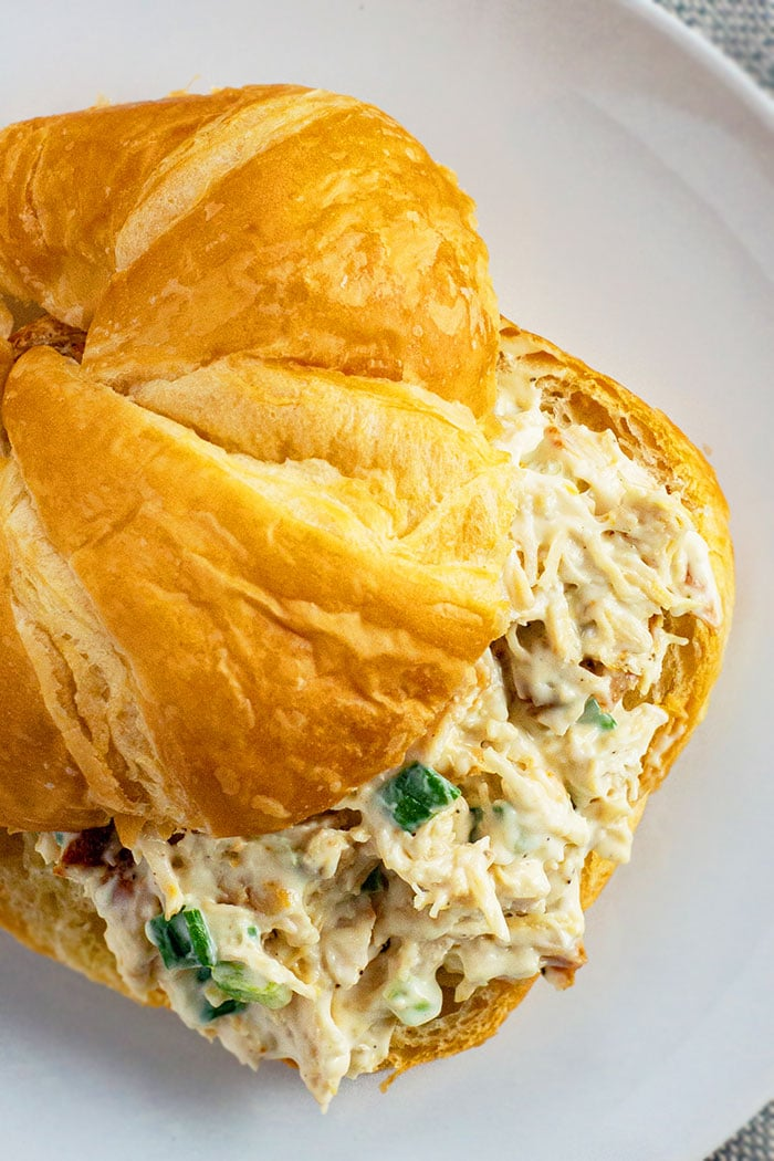 Old Fashioned Leftover Turkey Salad Sandwich With Croissant on White Plate- Closeup Shot