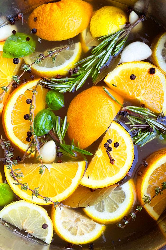 Closeup Shot of Apple Cider Turkey Brine with Fresh Herbs, Lemon Slices Orange Slices