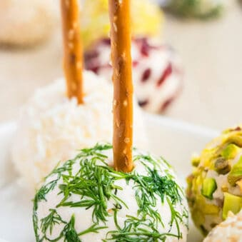 Easy Mini Cream Cheese Balls on White Plate With Various Toppings