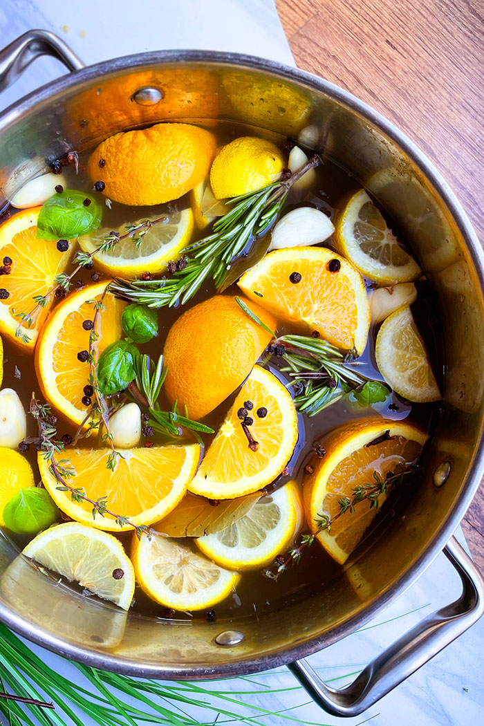 Citrus Brine in Silver Pot on White Background