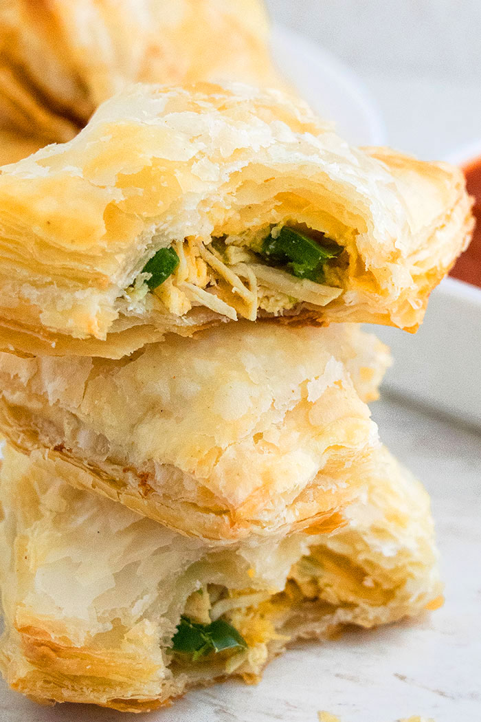 Stack of Chicken Puff Pastry with Partial Bite on One Puff