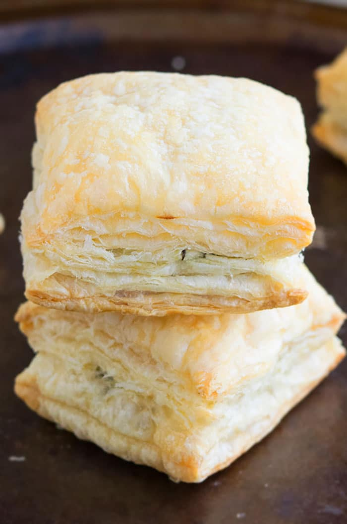 Stack of Two Cheesy Spinach Puff Pastry, Placed on Rustic Black Tray