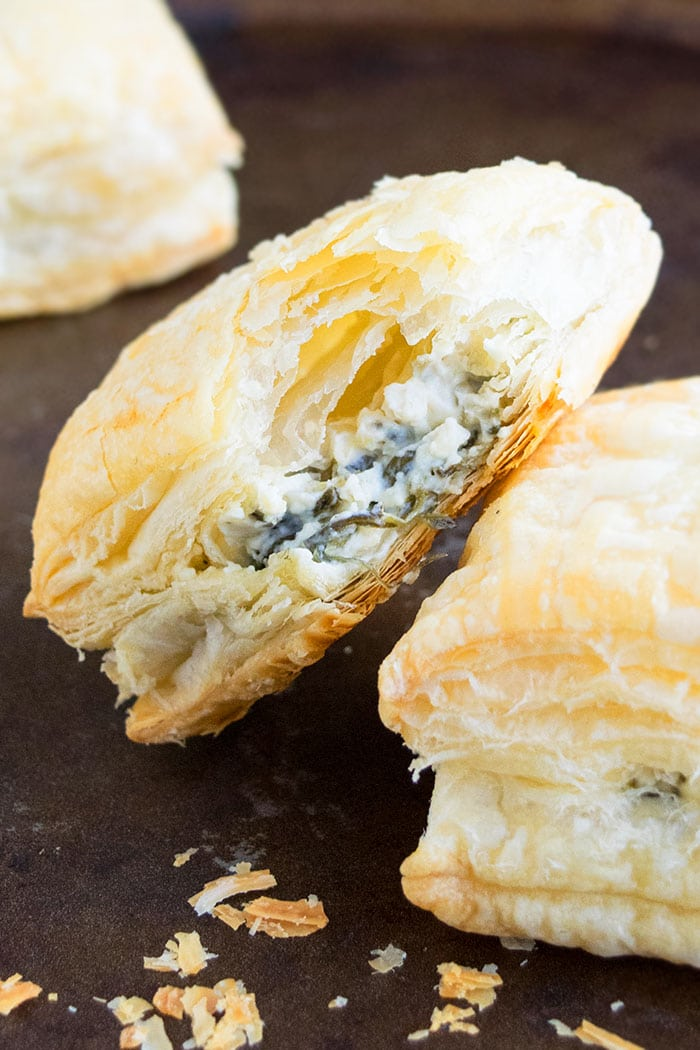 Easy Homemade Spinach Puffs with Cheese and Italian Herbs, Placed on Rustic Black Tray