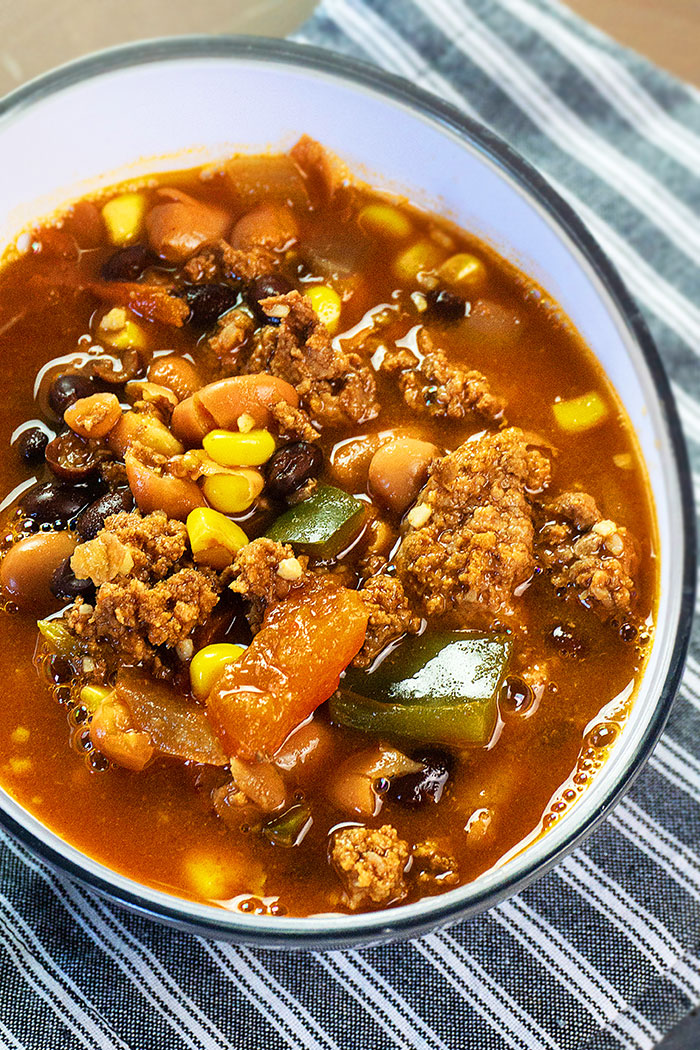 Easy Homemade Mexican Taco Soup in White Bowl- Overhead Shot