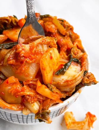 Easy Homemade Korean Kimchi Cabbage in White Bowl on White Background