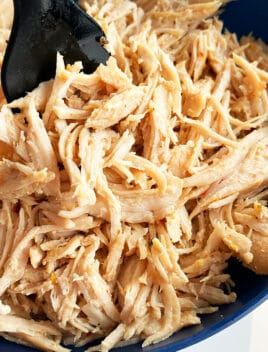 Easy Juicy Instant Pot Shredded Chicken Served in Blue Bowl