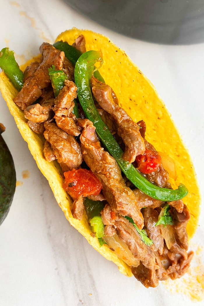 Overhead Shot of Mexican Steak Tacos in Hard Taco Shell on White Background