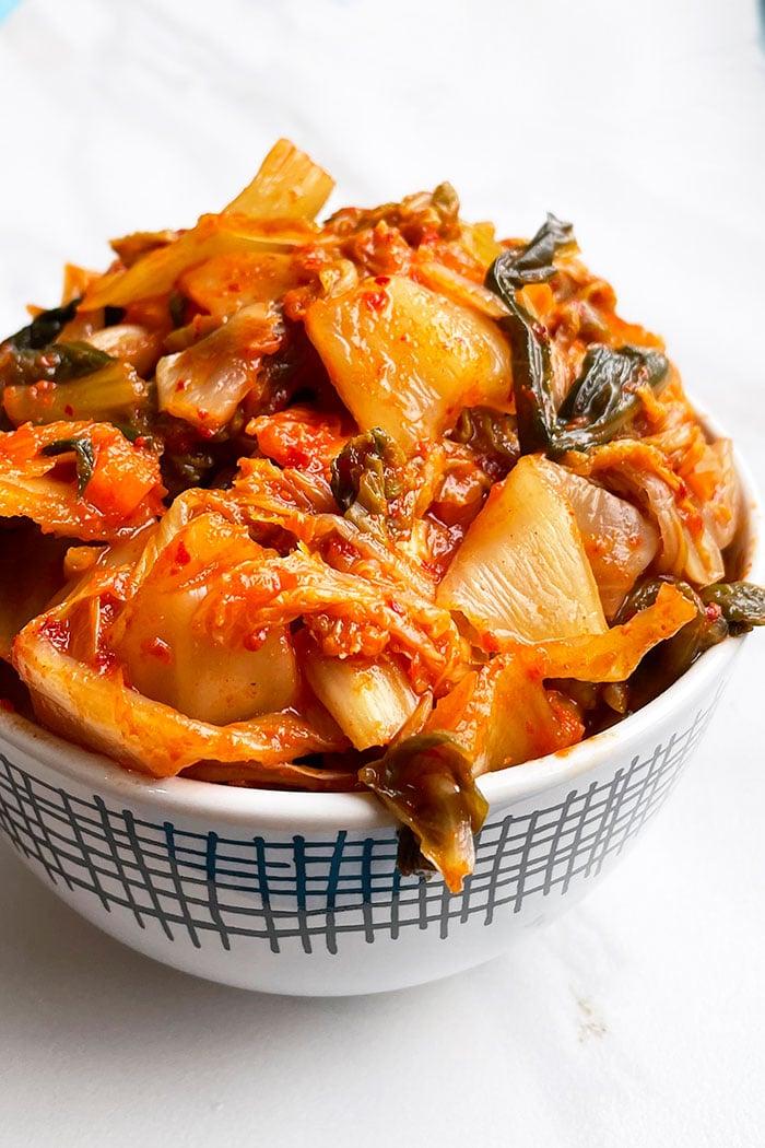 Easy Homemade Kimchi in White Bowl on White Background