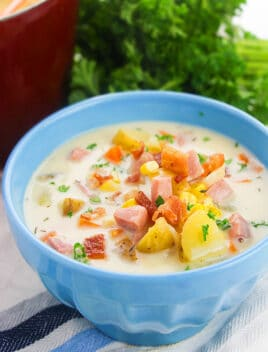 Easy Homemade Instant Pot Corn Chowder with Ham, Bacon and Potatoes, Served in Blue Bowl