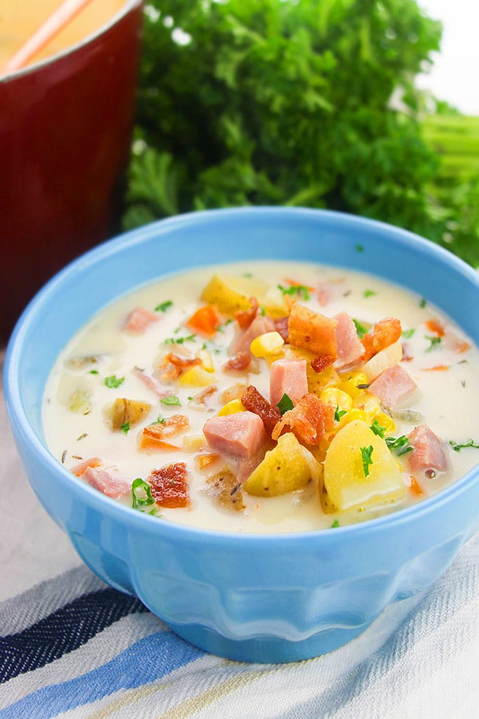 Instant Pot Corn Chowder with Ham, Bacon and Potatoes, Served in Blue Bowl