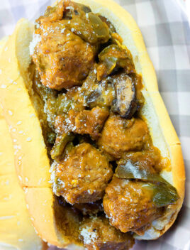 Easy Homemade Meatball Sub Sandwich Made in Instant Pot and Served on Gray Checkered Plate