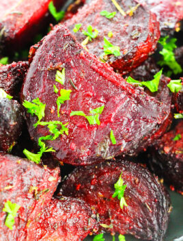 Easy Homemade Oven Roasted Beets in Black Plate with Italian Herbs on Black Plate