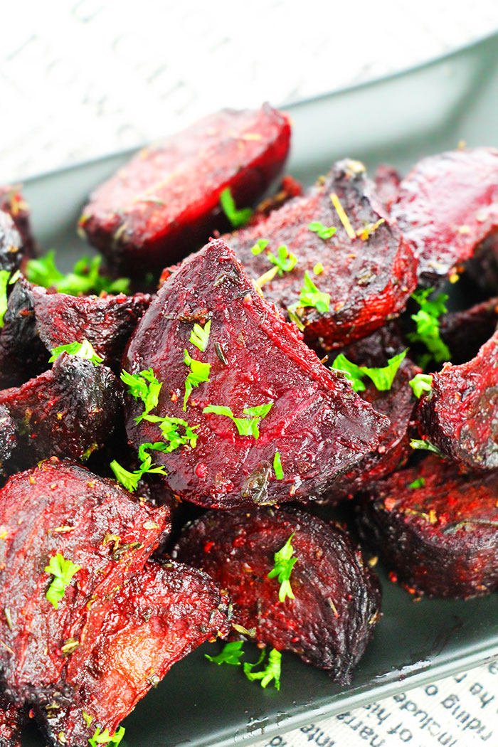 Easy Oven Roasted Beets in Black Plate with Parsley Garnish