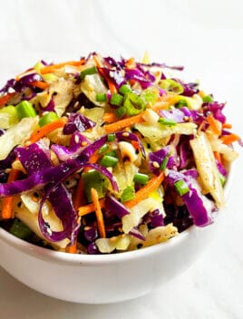 Easy Asian Slaw in White Bowl on White Background