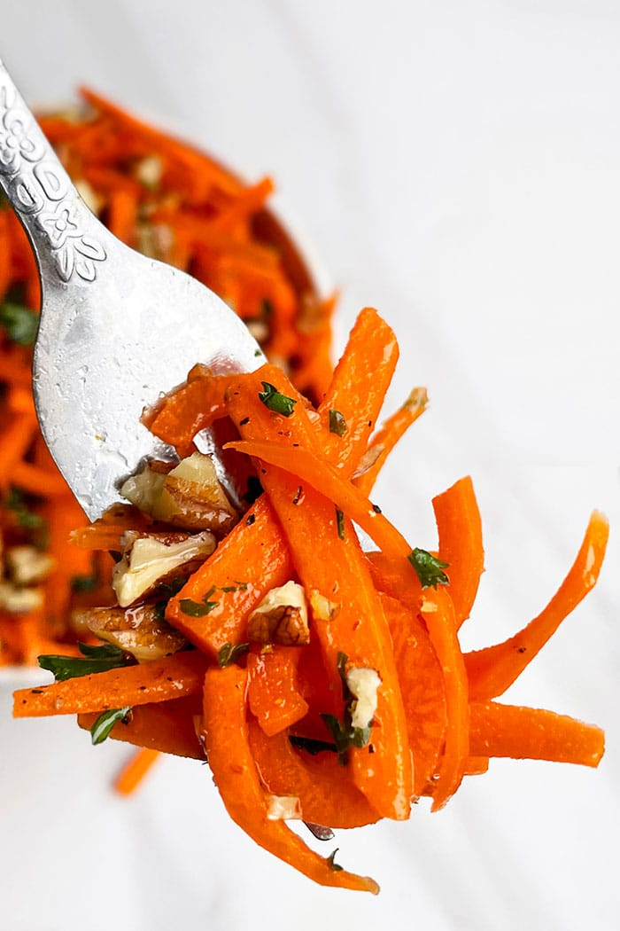 Fork Full of Carrot Coleslaw on White Background- Closeup Shot