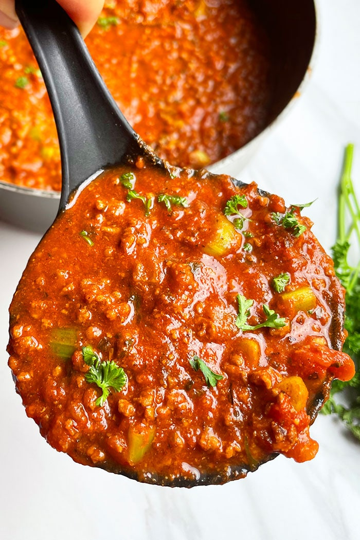 Spoonful of Best Beef Bolognese Sauce on White Background