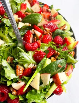 Best Summer Salad in Black Plate on White Background