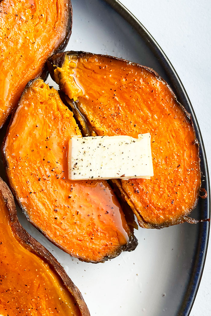 Instant Pot Sweet Potatoes Served in White Dish on White Background