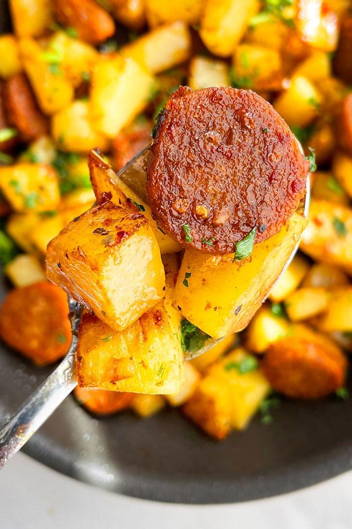 Closeup Shot of Spoonful of Kielbasa and Potatoes