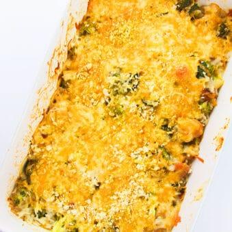 Easy Chicken Broccoli Rice Casserole in White Dish on White Background- Overhead Shot