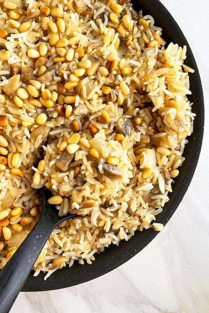 Vegetarian Rice Pilaf in Black Pot With Black Spoon- Overhead Shot