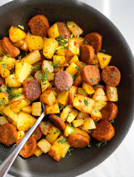 Easy Sausage and Potatoes Made in Instant Pot and Served in Black Dish