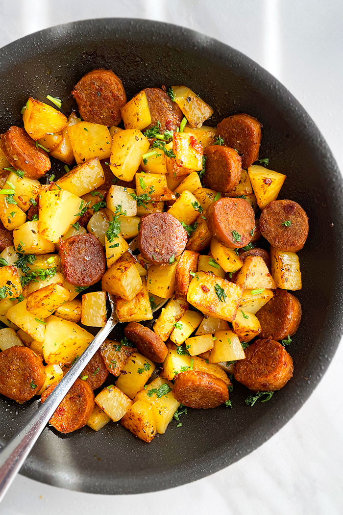 Easy Italian Sausage and Potatoes Made in Instant Pot and Served in Black Dish