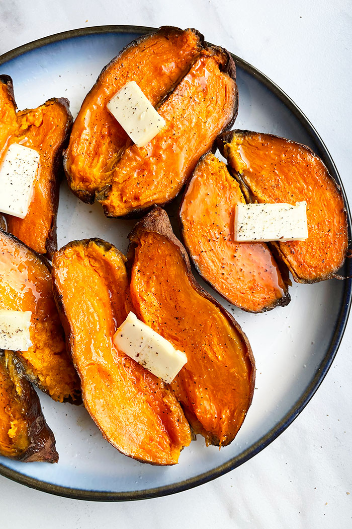 Easy Baked Sweet Potatoes Served in White Dish on White Background