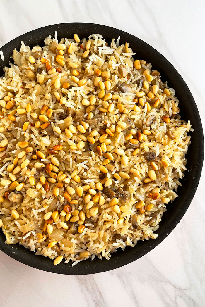 Easy Mushroom Rice in Black Pot on White Background