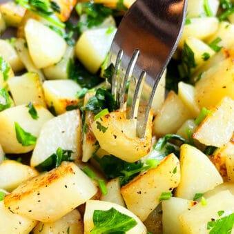 Fork Full of Easy Parsley Potatoes- Closeup Shot