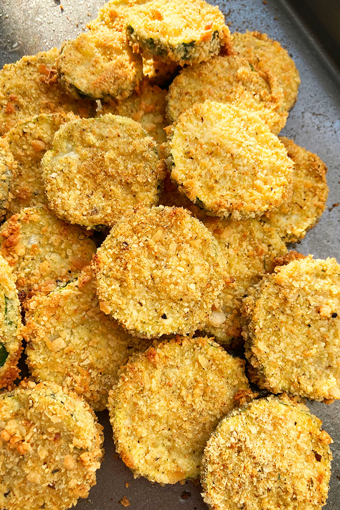 Baking Tray Filled With Crispy Courgette Chips