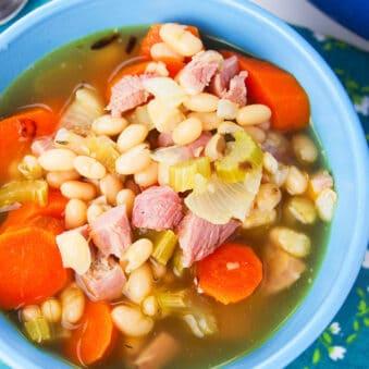 Easy Instant Pot Leftover Ham Bone Soup Served in Blue Bowl