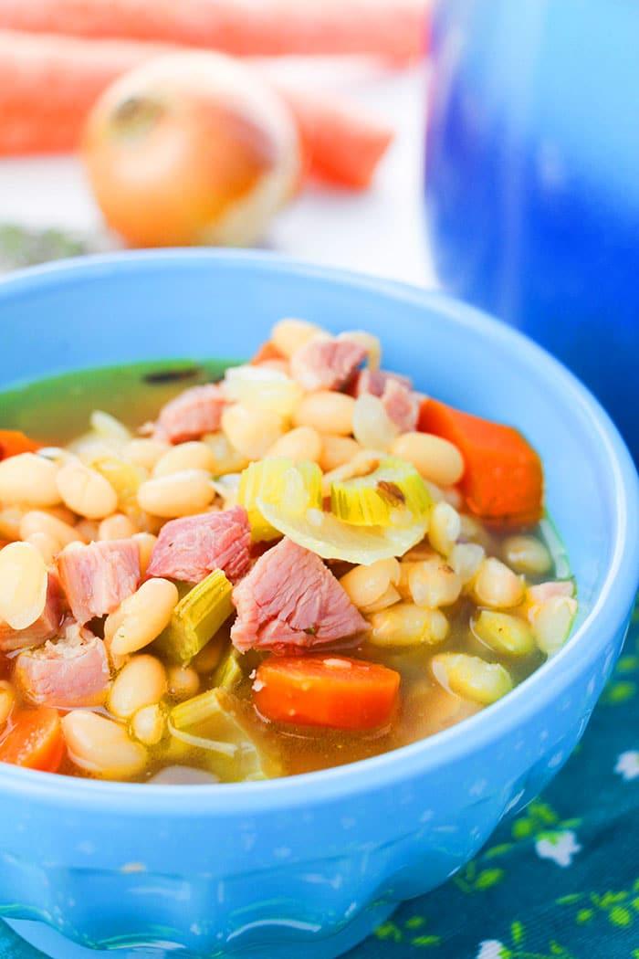Instant Pot Ham Bone Soup Served in Blue Bowl
