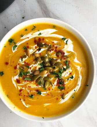 Instant Pot Pumpkin Soup Served in White Bowl