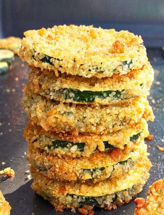 Stack of Easy Oven Baked Zucchini Chips on Baking Tray