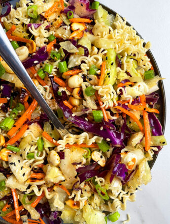 Easy Asian Ramen Noodle Salad in Black Dish on White Background