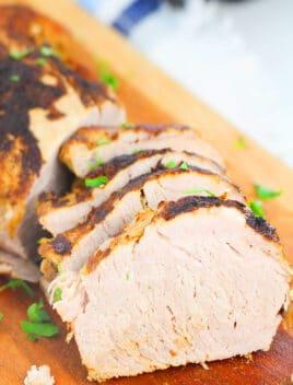 Easy Tender Moist Instant Pork Tenderloin Slices on Brown Cutting Board